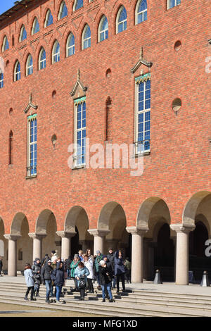 Group of tourists in Stockholm City Hall (Stadshuset) - Stock Photo