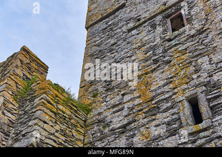 A Close up of the Stone walls of Slade castle on the Hook Peninsula in County Wexford, Southern Ireland. - Stock Photo