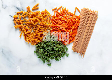 different types of gluten-free paste from chickpeas, red lentils, algae and healthy cereals on a white marble table. shot from above. food background - Stock Photo