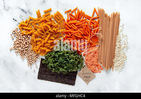different types of gluten-free paste from chickpeas, red lentils, algae and healthy cereals on a white marble table. labels for writing text. shot fro - Stock Photo