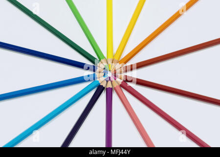 Color pencils isolated on white arranged in circle. - Stock Photo