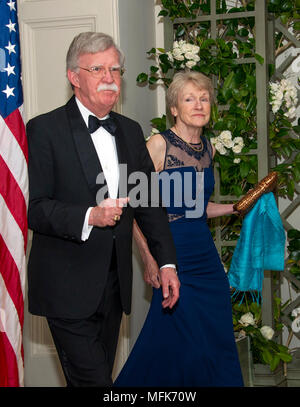 Washington, USA. 24th Apr, 2018. National Security Advisor John Bolton and Mrs. Gretchen Bolton arrive for the State Dinner honoring Dinner honoring President Emmanuel Macron of the French Republic and Mrs. Brigitte Macron at the White House in Washington, DC on Tuesday, April 24, 2018. Credit: Ron Sachs/CNP - NO WIRE SERVICE - Credit: Ron Sachs/Consolidated News Photos/Ron Sachs - CNP/dpa/Alamy Live News - Stock Photo