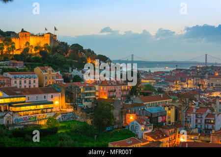 Lisbon skyline, view across the rooftops of the Mouraria in the center of Lisbon towards the River Tagus and the Ponte 25 de Abril bridge, Portugal. - Stock Photo
