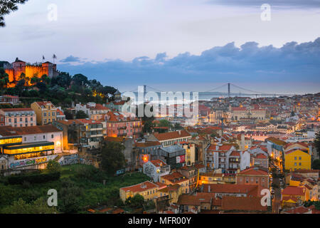 Lisbon cityscape, view across the rooftops of the Mouraria in the center of Lisbon towards the River Tagus and the Ponte 25 de Abril bridge, Portugal. - Stock Photo