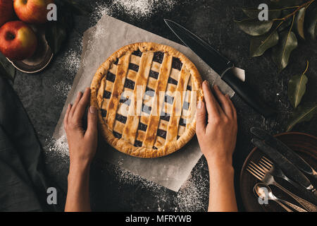 female hands and apple pie - Stock Photo