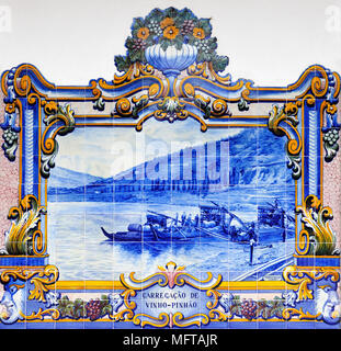 Traditional blue tiles (Azulejos) showing the work related with the Port Wine. Railway station of Pinhão, Douro region. A Unesco World Heritage Site,  - Stock Photo