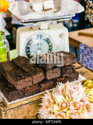 A Stack of Chocolate Brownies on a wooden box for display purposes. - Stock Photo