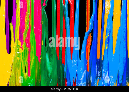 colorful of plastisol ink are dripping by in opposite directions - Stock Photo