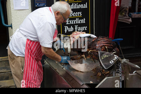 Summer hog roast outside a pub in the UK - Stock Photo