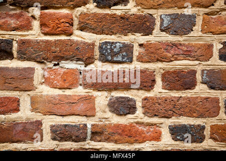 Antique early American handmade brick wall in Colonial Williamsburg Virginia Still life - Stock Photo