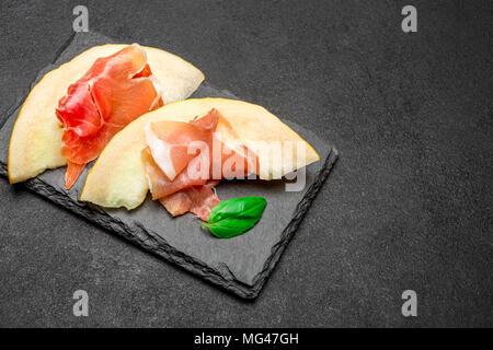 Prosciutto with melon.Traditional Italian appetizer - Stock Photo