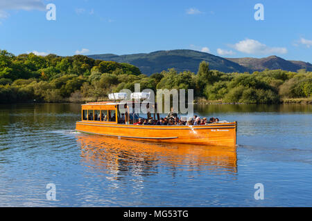 The Lady Derwentwater motor launch departing Keswick landing stage on Derwent Water in the Lake District National Park, Cumbria, England - Stock Photo