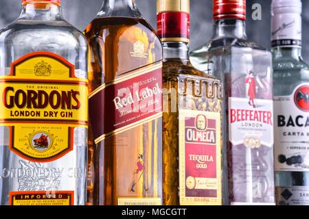 POZNAN, POLAND - MAR 30, 2018: Bottles of assorted global hard liquor brands - Stock Photo