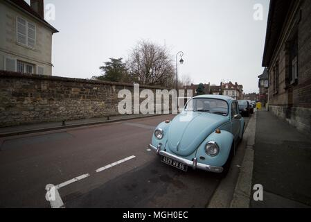 1960's Light blue Volkswagen Beetle parked up on an old street in Paris (Beetle parked on road) - Stock Photo