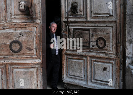 Wajeeh Nuseibeh, a Muslim whose family has opened and closed the Holy Sepulcher since the Ottoman era closing the doors of the church of Holy sepulchre in old city East Jerusalem Israel. The custody of the door and the key for the Church of the Holy Sepulchre is entrusted to two Muslim families (Nuseibeh and Judeh) and it has been like this for centuries. - Stock Photo