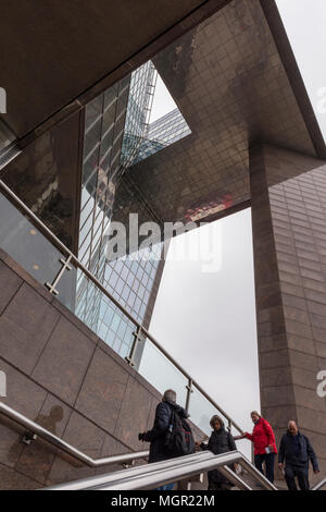 Some people walking down or up the steps or stairs at number one 1 London Bridge office building beside the river thames central london capital city. - Stock Photo