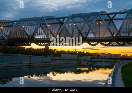 Bridge by Perrault and river Manzanares, night view. Madrid Rio park, Madrid, Spain. - Stock Photo