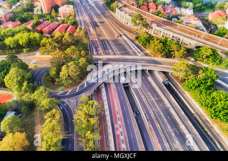 Multi-lane intersection on Warringah freeway in North Sydney approaching Sydney Harbour bridge - aerial top down view between local residential suburb - Stock Photo