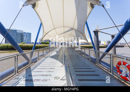London, United Kingdom - June 11, 2015: A white canopy protects boarding and departing passengers from the Thames Clipper on the River Thames. - Stock Photo
