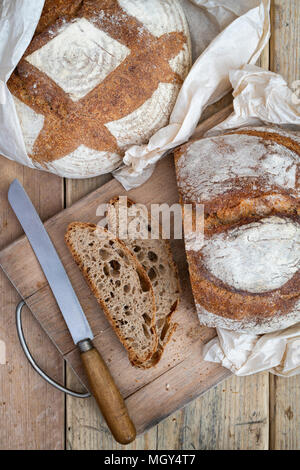 Sourdough bread and spelt sourdough bread on a bread board. UK - Stock Photo