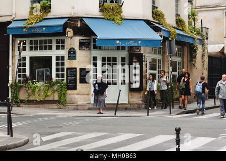 French Restaurant and Walking People in Paris - Stock Photo