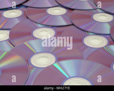 Blank DVDs are on display with the reflective side facing up. - Stock Photo