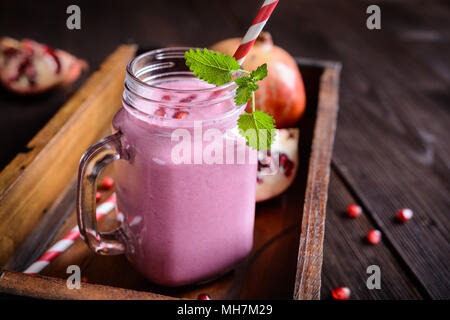 Refreshing pomegranate smoothie in a glass jar - Stock Photo