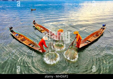 Three fisherman in inle lake - Stock Photo