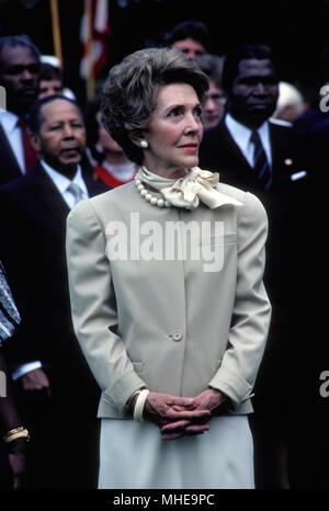 Washington, DC, USA, 7th June, 1983 First Lady Nancy Reagan during the Offical Arrival ceremony  For President Felix Houphuet-Boigny of the Ivory Coast and Mrs. Felix Houphouet-Boigny on the South Lawn of the White House. Credit:Mark Reinstein /MediaPunch - Stock Photo