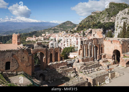 Ancient Greek-Roman theatre of Taormina with town and Mount Etna, Sicily. - Stock Photo