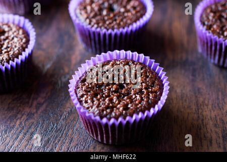 Mini Chocolate Cake Souffle on wooden surface. Dessert Concept. - Stock Photo