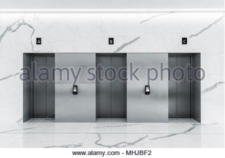 Modern minimalist business centre lobby interior with three closed steel lift doors - Stock Photo