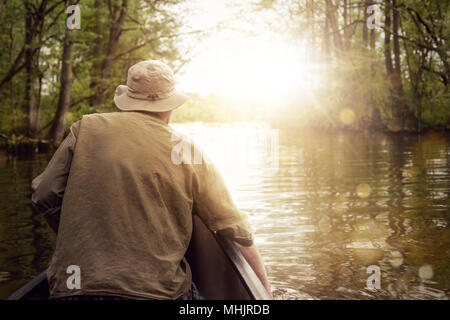 Canoeing on a lake in the forest - Stock Photo