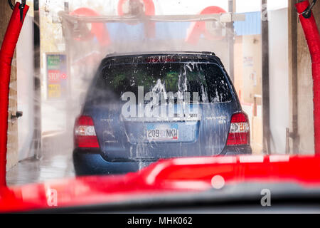 View through auto windshield; automobile in automated car wash - Stock Photo