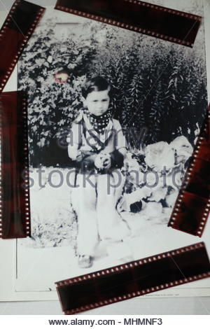 Compositions - The Cowboy - Portrait of JW Cowles as a young boy, dressed in cowboy costume in the garden of his childhood home, Merton,Morden Surrey. - Stock Photo