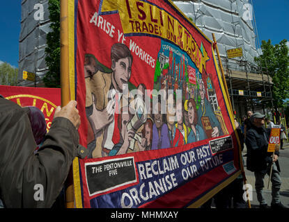 Demonstrators display banners with Marxist themes during International Workers May Day rally on 1st May 2018 in London,England,UK - Stock Photo