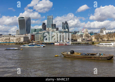 A London cityscape of the River Thames featuring the Gherkin, Cheesegrater and Walkie-talkie skyscrapers amongst the London city skyline. - Stock Photo