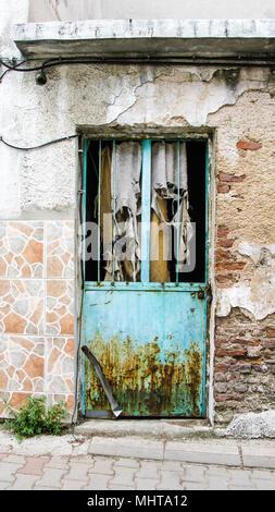 Old door with rusty metal details - Stock Photo