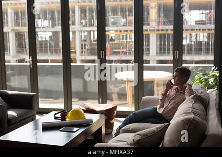 Female architect talking on the mobile phone - Stock Photo