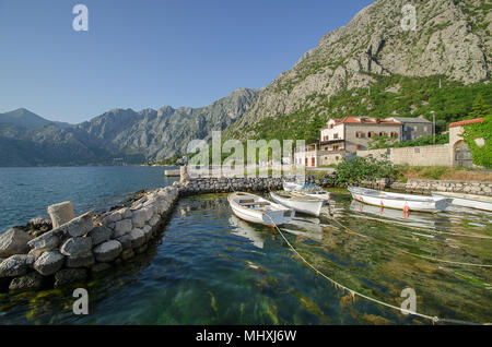 The beautiful town of Dobrota with Orahovac village in the distance, Kotor Bay, Boka Kotorska, Montenegro. - Stock Photo