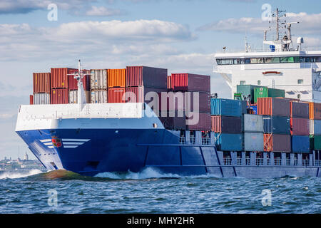 container vessel and ferry on high sea - Stock Photo