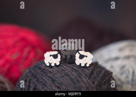 White and black sheep on the yarn balls, knitting postcard concept, toned - Stock Photo