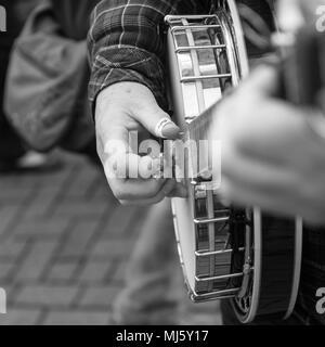 Banjo playing street performer in Banbury, UK 2017 - Stock Photo