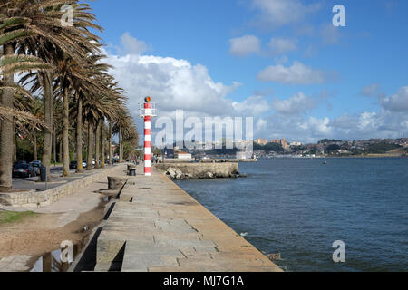 Lighthouse and sidewalk in the city Porto, Portugal. - Stock Photo