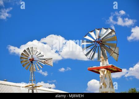 Two windmill on an agricultural farm in Oklahoma, USA. - Stock Photo