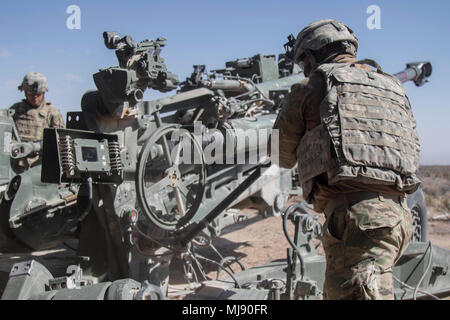 Spc. Matthew Berholtz and his crew with Charlie Battery, 2nd Battalion, 3rd Field Artillery, 1st Brigade, 1st Armored Division prepare to fire a round at Orogrande, Rang Complex, New Mexico, on April 19, 2018. Hustler Trough is a week long exercise hosted by 2-3 FA artillerymen with Air Force pilots from the 66th Weapons Squadron, United States Air Force Weapons School, Nellis Air Force Base, Nevada to test operational effectiveness between the Army and Air Force. (U.S. Army photo by Sgt. Alon Humphrey) - Stock Photo