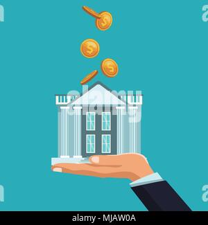 Coins falling to bank building - Stock Photo