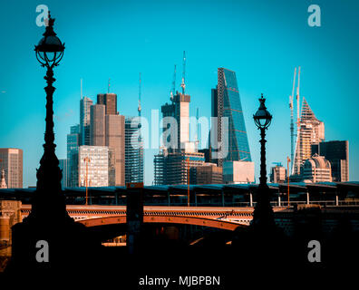 Sunrise view over London City's Financial District Skyline from South of the River Thames - Stock Photo