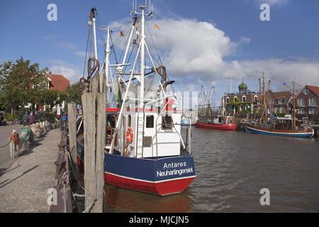 Fishing trawler in the harbour of Neuharlingersiel, Lower Saxony, North Germany, Germany, Europe, - Stock Photo