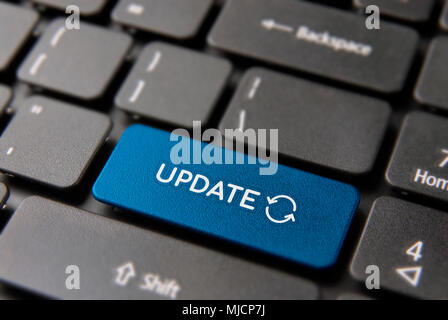 Online update computer keyboard button for internet software concept. Updating process keypad key in blue color. - Stock Photo
